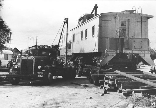 Union Pacific caboose being secured onto transport